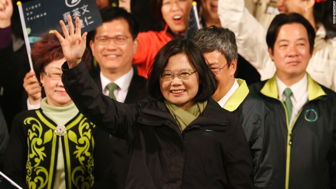 Democratic Progressive Party candidate Tsai Ing-wen raises her hands as she declares victory in the presidential election on Saturday, January 16 in Taipei.