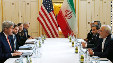 """US Secretary of State John Kerry (L)  meets with Iranian Foreign Minister Javad Zarif (R) in Vienna, Austria on January 16, 2016, on what is expected to be """"implementation day,""""  the day the International Atomic Energy Agency (IAEA) verifies that Iran has met all conditions under the nuclear deal.    / AFP / POOL / KEVIN LAMARQUE        (Photo credit should read KEVIN LAMARQUE/AFP/Getty Images)"""
