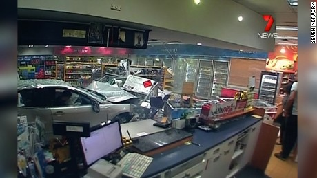 cnnee vo captures moment car slams into service station _00002217