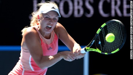 MELBOURNE, AUSTRALIA - JANUARY 18:  Caroline Wozniacki of Denmark plays a backhand in her first round match against Yulia Putintseva of Kazakhstan during day one of the 2016 Australian Open at Melbourne Park on January 18, 2016 in Melbourne, Australia.  (Photo by Michael Dodge/Getty Images)