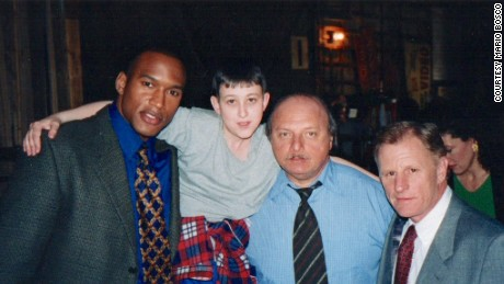 "In 2000 Bosco's (second from left) acting career got a boost when he appeared on ABC's ""NYPD Blue"" with (from left) Henry Simmons, Dennis Franz and Gordon Clapp."