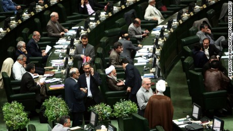 """Iranian members of parliament attend a parliamentary session in Tehran on June 23, 2015. Iranian lawmakers passed a bill obliging the government to safeguard the country's """"nuclear rights and achievements,"""" despite talks with global powers on curbing the Islamic republic's disputed atomic programme. AFP PHOTO / BEHROUZ MEHRI        (Photo credit should read BEHROUZ MEHRI/AFP/Getty Images)"""
