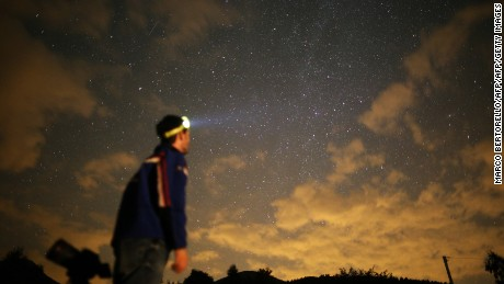 A photographer prepares to take pictures of the annual Perseid meteor shower in the village of Crissolo, near Cuneo, in the Monviso Alps region of northern Italy, on August 13, 2015. The Perseid meteor shower occurs every year when the Earth passes through the cloud of debris left by Comet Swift-Tuttle. AFP PHOTO / MARCO BERTORELLO        (Photo credit should read MARCO BERTORELLO/AFP/Getty Images)