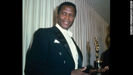 Bahamian American actor Sidney Poitier holding his Academy Award for Best Actor in a Leading Role for 'Lilies Of The Field', directed by Ralph Nelson, at the 36th Academy Awards ceremony, 13th April 1964. The ceremony was held at the Santa Monica Civic Auditorium, Santa Monica, California. (Photo by Archive Photos/Getty Images)