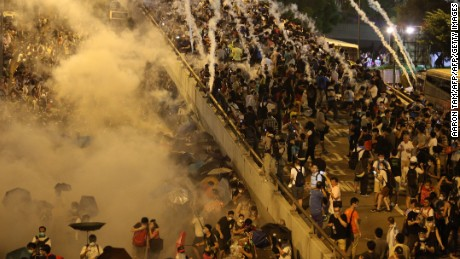 Police fire tear gas at Hong Kong pro-democracy demonstrators.