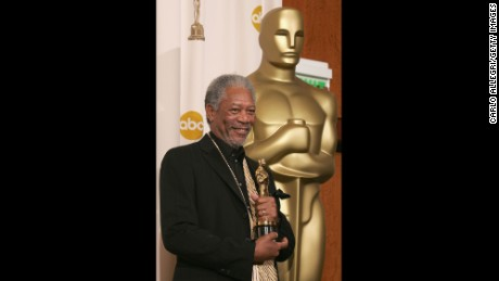 "HOLLYWOOD - FEBRUARY 27:  Actor Morgan Freeman poses backstage with his Oscar for Best Actor in a Supporting Role in ""Million Dollar Baby"" during the 77th Annual Academy Awards on February 27, 2005 at the Kodak Theater in Hollywood, California. (Photo by Carlo Allegri/Getty Images)"