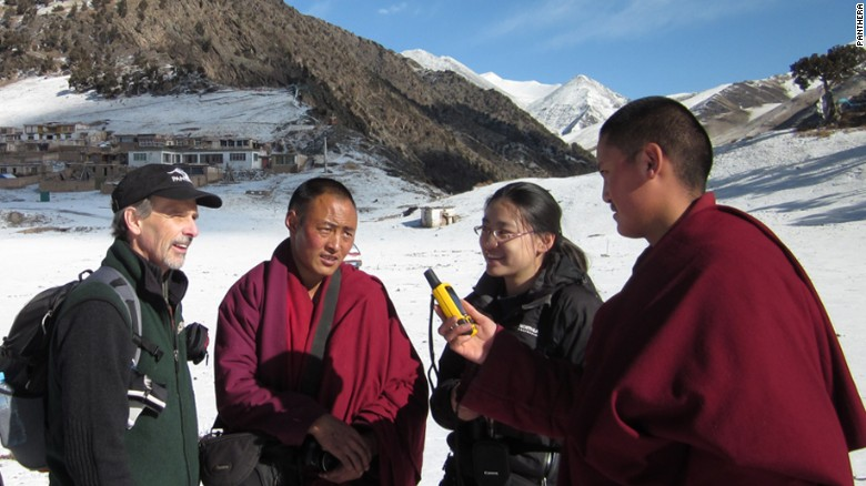Tom McCarthy, left, executive director,  Panthera Snow Leopard program and Yin Hang from Chinese NGO Yin Hang, second right, discuss snow leopard monitoring methods with Buddhist monks.