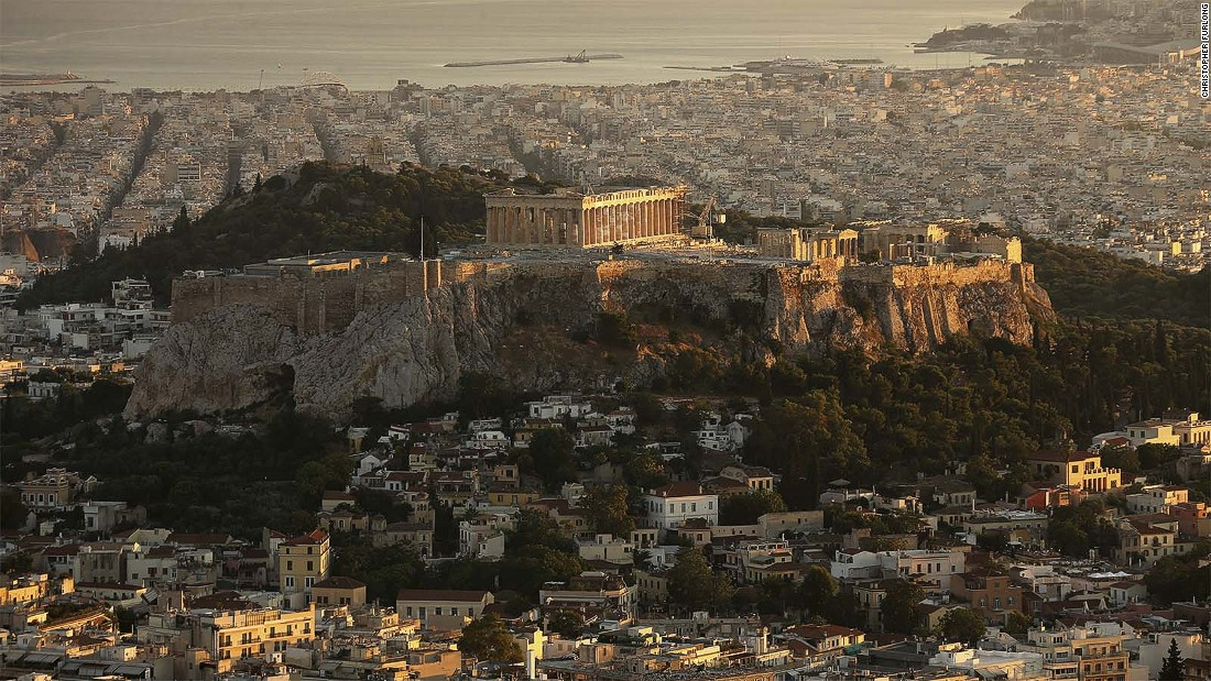 "Adjacent to The Acropolis, pictured, Koukaki sits at the bottom of the Lofos Filopappou and is home to some ancient treasures of its own. ""After it became a pedestrian playground, the street morphed to have a cafe-like feel with all of the restaurants and bars placing tables and chairs outside,"" says the Airbnb report."