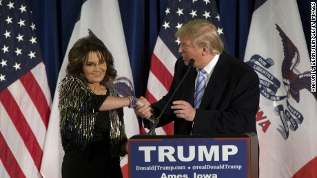 Republican presidential candidate Donald Trump shakes hands with former Alaska Gov. Sarah Palin at Hansen Agriculture Student Learning Center at Iowa State University on January 19, 2016 in Ames, IA.