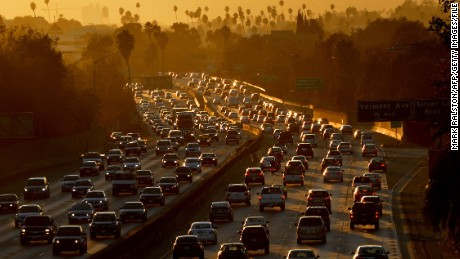 Heavy traffic clogs the 101 Freeway as people leave work for the Labor Day holiday in Los Angeles on August 29, 2014.  A Labor Day travel prediction by the American Auto Association (AAA) expects that 34.7 million Americans will journey 50 miles or more from home during the Labor Day holiday weekend, mainly due to lower gas prices and a rebounding economy.             AFP PHOTO/Mark RALSTON        (Photo credit should read MARK RALSTON/AFP/Getty Images)
