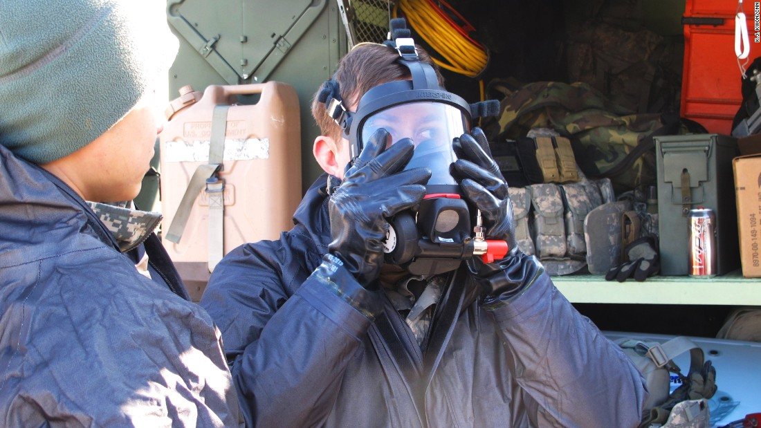 Troops from the 23rd Chemical Battalion suit up in protective gear ahead of the drill.