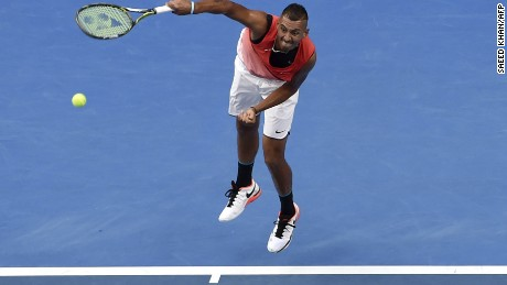 Australia's Nick Kyrgios hits a return against Uruguay's Pablo Cuevas during their men's singles match on day three of the 2016 Australian Open tennis tournament in Melbourne on January 20, 2016. AFP PHOTO / SAEED KHAN-- IMAGE RESTRICTED TO EDITORIAL USE - STRICTLY NO COMMERCIAL USE / AFP / SAEED KHAN        (Photo credit should read SAEED KHAN/AFP/Getty Images)
