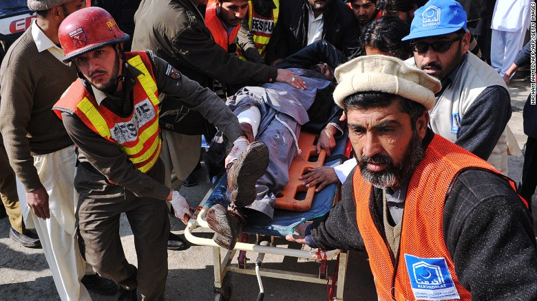 Rescuers transport an injured man to hospital following an attack by gunmen on Bacha Khan University in Charsadda, Pakistan, on January 20, 2016.