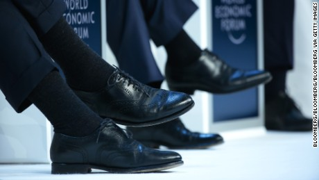 A speaker wears leather brogue shoes during a panel session at the World Economic Forum (WEF) in Davos, Switzerland, on Thursday, Jan. 21, 2016. World leaders, influential executives, bankers and policy makers attend the 46th annual meeting of the World Economic Forum in Davos from Jan. 20 - 23. Photographer: Jason Alden/Bloomberg via Getty Images
