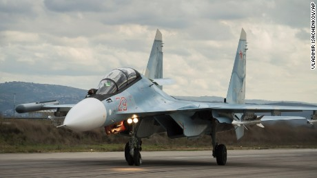 A Russian fighter jet lands at Hemeimeem air base in Syria Wednesday, January 20, 2016. Russian warplanes have flown over 5,700 combat missions since Moscow launched its air campaign in Syria on Sept. 30, 2015.