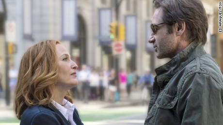 "Gillian Anderson as Dana Scully and David Duchovny as Fox Mulder in the Fox series ""The X-Files."""