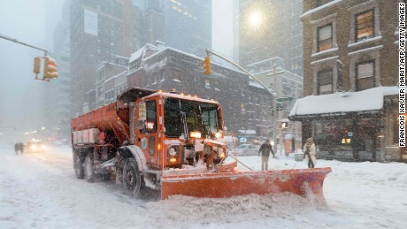 A snowplow clears snow on Lexington Avenue during the snowstorm January 2016 in New York.
