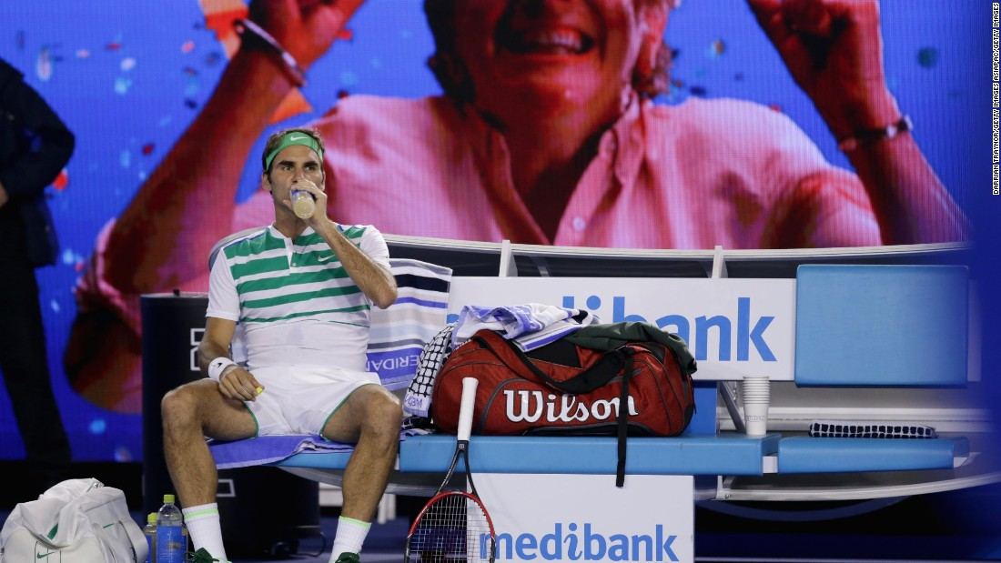 Third seed Roger Federer takes a break during his straight sets rout of David Goffin of Belgium to reach the last 16.