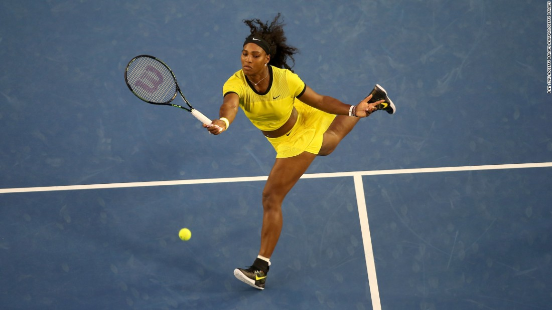 Williams powers a forehand as she continued her march to the last eight of the Australian Open in the defense of her title.