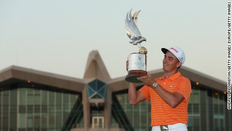 Rickie Fowler poses with the winning trophy after claiming the Abu Dhabi Championship.
