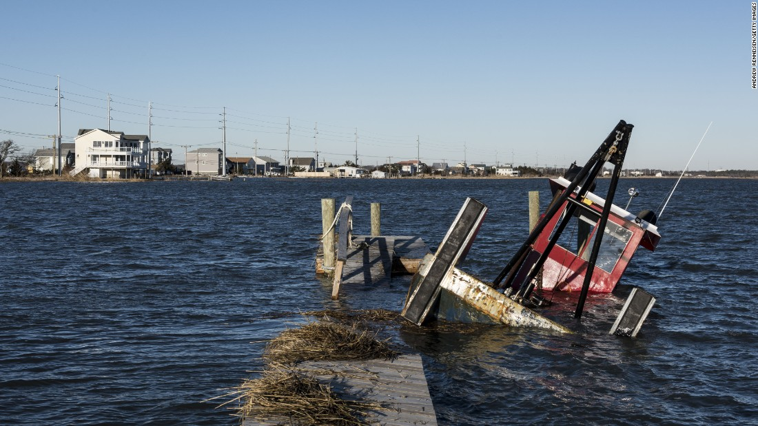 A boat is partly submerged in high water in Middle Township, New Jersey, on January 24.