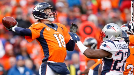 DENVER, CO - JANUARY 24:  Peyton Manning #18 of the Denver Broncos passes in the third quarter against the New England Patriots in the AFC Championship game at Sports Authority Field at Mile High on January 24, 2016 in Denver, Colorado.  (Photo by Ezra Shaw/Getty Images)