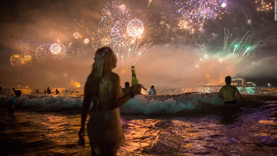 Fireworks light the sky over Copacabana Beach during New Year's Eve celebrations. Rio will host the Summer Olympics in August.