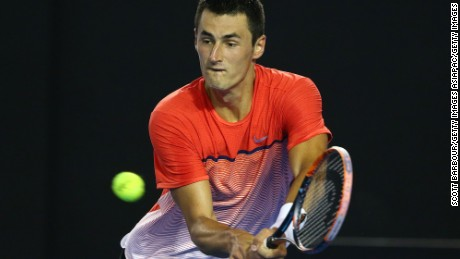MELBOURNE, AUSTRALIA - JANUARY 25:  Bernard Tomic of Australia plays a backhand in his fourth round match against Andy Murray of Great Britain during day eight of the 2016 Australian Open at Melbourne Park on January 25, 2016 in Melbourne, Australia.  (Photo by Scott Barbour/Getty Images)