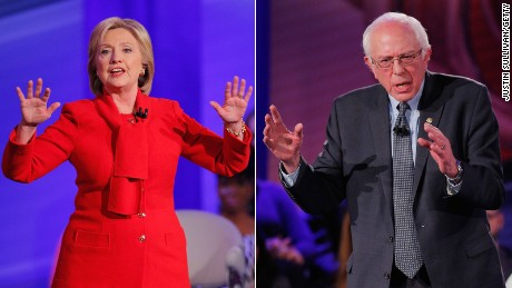 Hillary Clinton and Bernie Sanders are pictured at the CNN Democratic town hall in Des Moines, Iowa, on January 25, 2016, in this composite image.