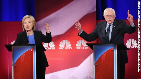CHARLESTON, SC - JANUARY 17:  Democratic presidential candidates Hillary Clinton (L) and Senator Bernie Sanders (I-VT) participate in the Democratic Candidates Debate hosted by NBC News and YouTube on January 17, 2016 in Charleston, South Carolina. This is the final debate for the Democratic candidates before the Iowa caucuses.  (Photo by Andrew Burton/Getty Images)