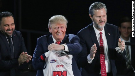 Liberty University President Jerry Falwell, Jr., right, presents Republican presidential candidate Donald Trump with a sports jersey after he delivered the convocation in the Vines Center at the university  January 18, 2016 in Lynchburg, Virginia.