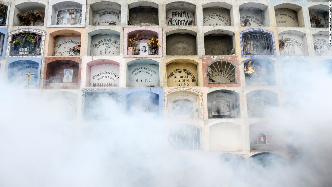 A graveyard in Lima, Peru, is fumigated on Friday, January 15.