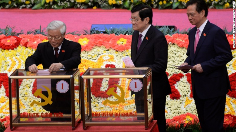 Party Secretary General Nguyen Phu Trong,left, and Prime Minister Nguyen Tan Dung, right, cast a vote during the congress.