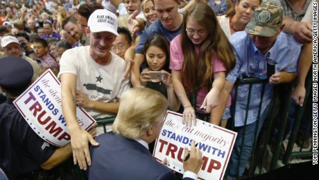 Republican presidential candidate Donald Trump greets supporters during a campaign rally at the American Airlines Center on September 14, 2015 in Dallas, Texas.