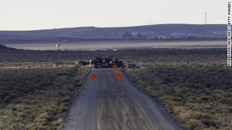 Law Enforcement Agencies operate a checkpoint on a road as a containment strategy surrounding the Malheur Wildlife Refuge January 27, 2016 near Burns, Oregon.  Although leaders of a group that illegally occupied the federal buildings were arrested, many armed occupants still on site have said that they intend to stay despite repeated requests to leave. The iconic wildlife tower of the buildings is visible in the upper left of this photograph.  / AFP / Rob Kerr        (Photo credit should read ROB KERR/AFP/Getty Images)