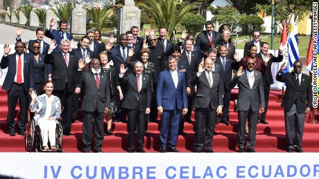 Presidents and other representatives pose for the family picture of the IV Community of Latin American and Caribbean States (CELAC) summit at the Union of South American Nations (UNASUR) headquarters in Quito on January 27, 2016. AFP PHOTO / CRIS BOURONCLE / AFP / CRIS BOURONCLE        (Photo credit should read CRIS BOURONCLE/AFP/Getty Images)