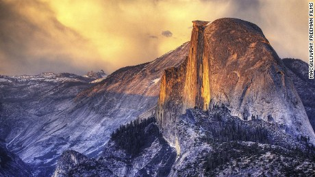 Half Dome rises 4,737 feet above the Merced River on the floor of Yosemite Valley in California.