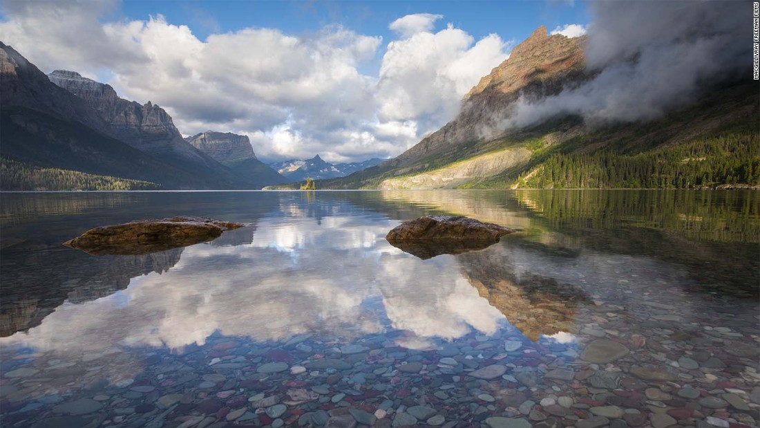 In Montana's Glacier National Park, reflections in St. Mary's Lake capture the expansiveness of the landscapes protected by the National Park Service.