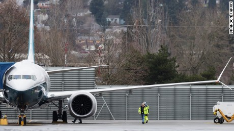 Workers give the 737MAX one final walk around before engine start.