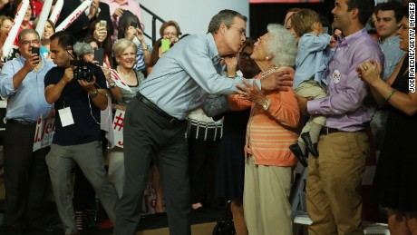 Former Florida Governor Jeb Bush kisses his mother Barbara Bush as he is introduced to announce his candidacy for the Republican presidential nomination during an event at Miami-Dade College - Kendall Campus on June 15 , 2015 in Miami, Florida.