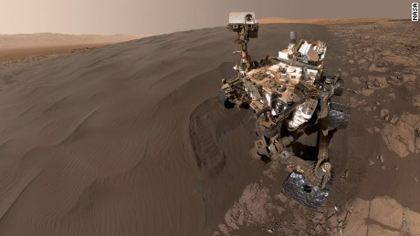 "NASA's Curiosity Mars rover took this selfie while sitting at ""Namib Dune."" The rover is has been scooping up sand from the dune to analyze. The photo combines 57 images taken on January 19, 2016 during the rover's 1,228th Martian day, or sol. The photos were taken with the Mars Hand Lens Imager at the end of the rover's robotic arm."