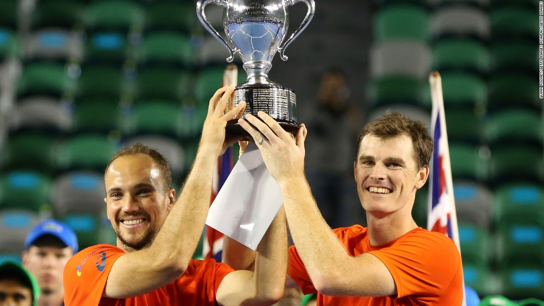 Jamie Murray of Britain (right) and Bruno Soares of Brazil lift the men's doubles trophy after beating Daniel Nestor of Canada and Radek Stepanek of Czech Republic in the final.