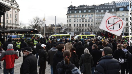 Protesters gather Saturday in Stockholm to show their disapproval of an anti-immigrant group's actions.