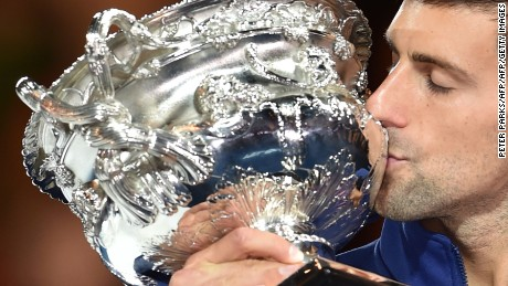Serbia's Novak Djokovic kisses The Norman Brookes Challenge Cup after his victory during the men's singles final against Britain's Andy Murray on day 14 of the 2016 Australian Open tennis tournament in Melbourne on January 31, 2016. AFP PHOTO / PETER PARKS -- IMAGE RESTRICTED TO EDITORIAL USE - STRICTLY NO COMMERCIAL USE / AFP / PETER PARKS        (Photo credit should read PETER PARKS/AFP/Getty Images)