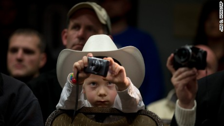 McCoy Wicker, 5, takes pictures of Republican presidential candidate Marco Rubio during a rally Saturday, January 30, in Council Bluffs, Iowa.