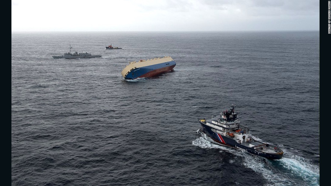 Several ships are standing by in attempt to right the ship.
