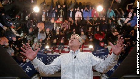 """MANCHESTER, NH - FEBRUARY 01:  Republican presidential candidate Jeb Bush holds a campaign town hall meeting at the Alpine Club February 1, 2016 in Manchester, New Hampshire. Getting ahead of the political spotlight by moving from the Midwest to the Northeast, Bush campaigned earlier in the day in Iowa, where voters will caucus Monday night, before landing in New Hampshire to focus on the """"First In The Nation"""" primary.  (Photo by Chip Somodevilla/Getty Images)"""