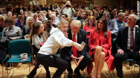 Republican presidential candidate Donald Trump, center, accompanied with wife, Melania, second from right, pauses for a selfie while visiting Saint Francis of Assisi Church, a caucus site, Monday, Feb. 1, 2016, in West Des Moines , Iowa. (AP Photo/Jae C. Hong)
