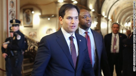U.S. Sen. Marco Rubio (R-FL) (L) and Sen. Tim Scott (R-SC) walk thorugh the U.S. Capitol February 12, 2014 in Washington, DC.