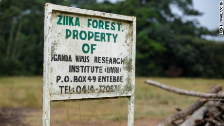 A well-worn sign is the only indication of the start of the Zika forest, Uganda's only preserve devoted entirely to science research.